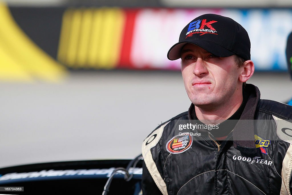 <a gi-track='captionPersonalityLinkClicked' href=/galleries/search?phrase=Ben+Kennedy+-+Racecar+Driver&family=editorial&specificpeople=15138183 ng-click='$event.stopPropagation()'>Ben Kennedy</a>, driver of the #96 <a gi-track='captionPersonalityLinkClicked' href=/galleries/search?phrase=Ben+Kennedy+-+Racecar+Driver&family=editorial&specificpeople=15138183 ng-click='$event.stopPropagation()'>Ben Kennedy</a> Racing Chevrolet, stands on the grid during qualifying for the NASCAR K&N Pro Series East DRIVE4COPD 125 at Bristol Motor Speedway on March 14, 2013 in Bristol, Tennessee.