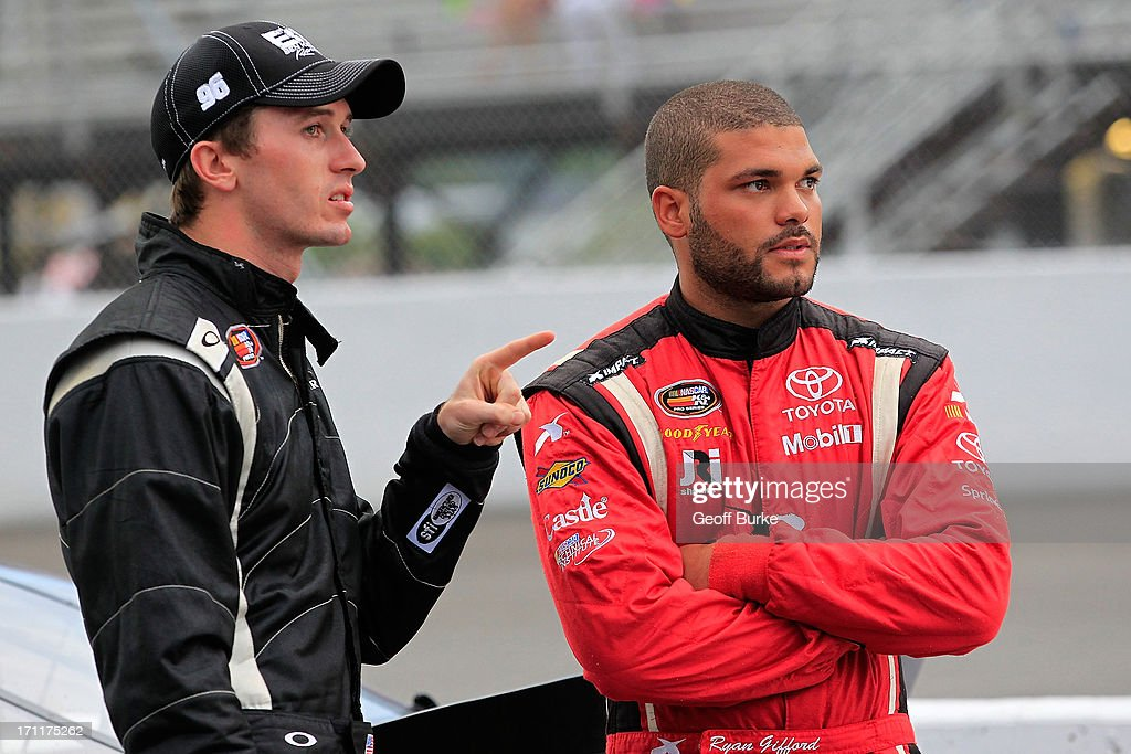 <a gi-track='captionPersonalityLinkClicked' href=/galleries/search?phrase=Ben+Kennedy+-+Racecar+Driver&family=editorial&specificpeople=15138183 ng-click='$event.stopPropagation()'>Ben Kennedy</a> ( l ), driver of the #96 <a gi-track='captionPersonalityLinkClicked' href=/galleries/search?phrase=Ben+Kennedy+-+Racecar+Driver&family=editorial&specificpeople=15138183 ng-click='$event.stopPropagation()'>Ben Kennedy</a> Racing Chevrolet, talks with Ryan Gifford ( r ), driver of the #2 Universal Technical Institute/NTI Toyota, on the grid prior to the NASCAR K&N Pro Series East Visit Hampton VA 175 at Langley Speedway on June 22, 2013 in Langley, Virginia.