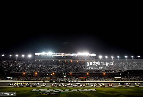 Ben Kennedy driver of the Florida Lottery/Whelen Chevrolet leads the field past the green flag to start the Camping World Truck Series NextEra Energy...