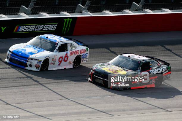 Ben Kennedy driver of the Hurricane Harvey Relief Chevrolet races Ty Dillon driver of the Bass Pro Shops/Tracker Boats Chevrolet during the NASCAR...