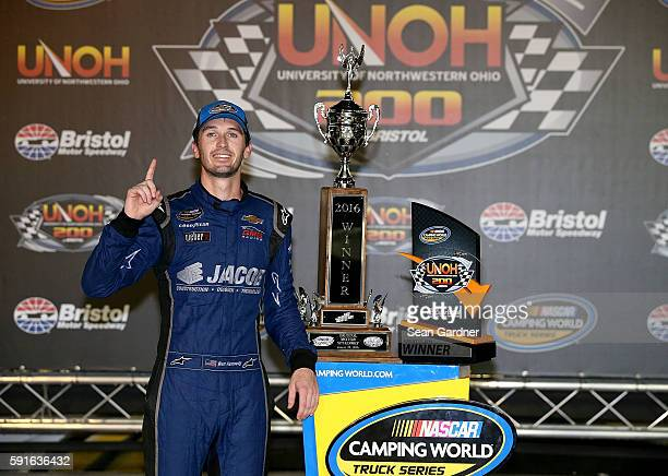 Ben Kennedy driver of the Jacob Chevrolet celebrates after winning the NASCAR Camping World Truck Series UNOH 200 at Bristol Motor Speedway on August...
