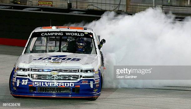 Ben Kennedy driver of the Jacob Chevrolet does a burnout after winning the NASCAR Camping World Truck Series UNOH 200 at Bristol Motor Speedway on...
