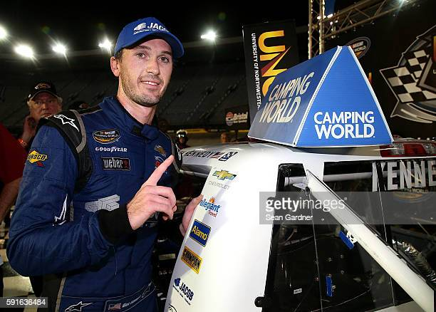 Ben Kennedy driver of the Jacob Chevrolet poses with the winners sticker after winning the NASCAR Camping World Truck Series UNOH 200 at Bristol...