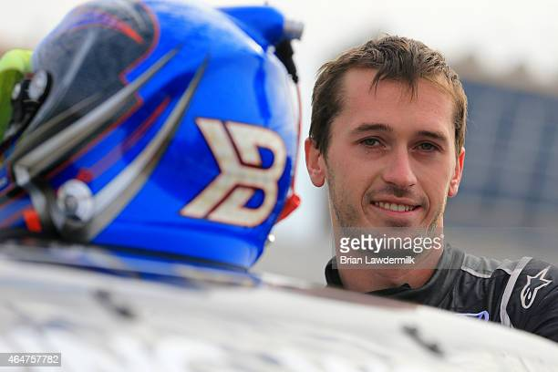 Ben Kennedy driver of the Local Motors Toyota stands on the grid during qualifying for the NASCAR Camping World Truck Series Hyundai Construction...