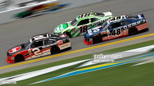 Ben Kennedy driver of the Rheem Chevrolet leads Daniel Suarez driver of the Interstate Batteries Toyota and Brennan Poole driver of the DC Solar...