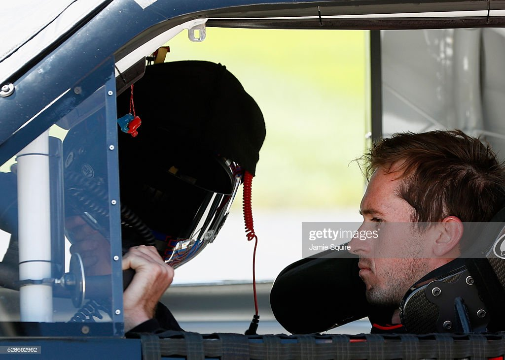 Ben Kennedy, driver of the #33 Weber Grill Chevrolet, looks on during qualifying for the NASCAR Camping World Truck Series Toyota Tundra 250 at Kansas Speedway on May 6, 2016 in Kansas City, Kansas.