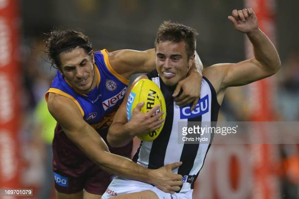 Ben Kennedy of the Magpies is tackled by Patrick Karnezis of the Lions during the round ten AFL match between the Brisbane Lions and the Collingwood...