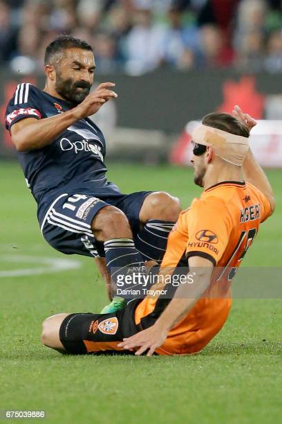 Ben Khalfallah of the Victory and Jack Hingert of the Roar and compete for the ball during the ALeague Semi Final match between Melbourne Victory and...