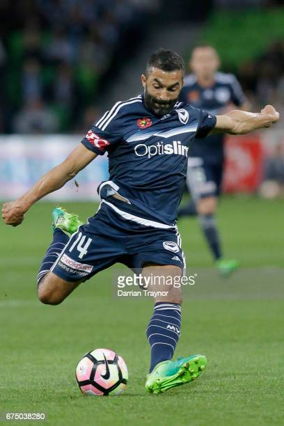 Ben Khalfallah of the Victory strikes the ball during the ALeague Semi Final match between Melbourne Victory and the Brisbane Roar at AAMI Park on...