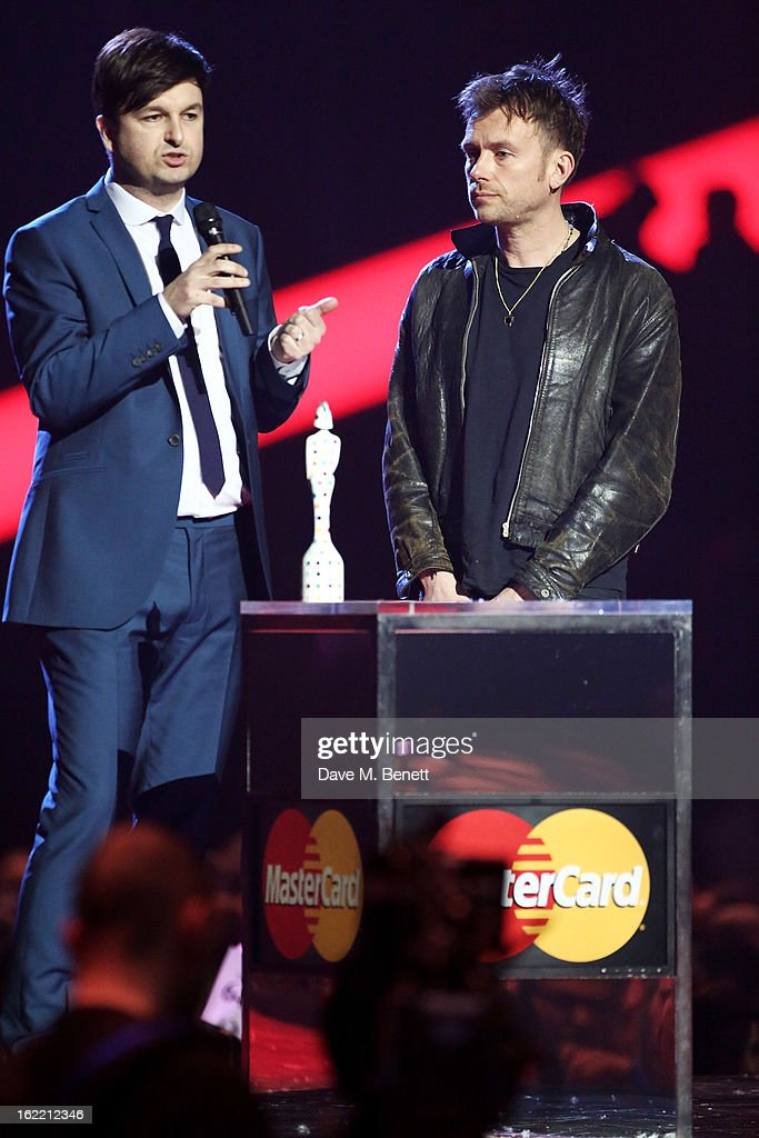 Ben Knowles of War Child accepts the Special Recognition award from <a gi-track='captionPersonalityLinkClicked' href=/galleries/search?phrase=Damon+Albarn&family=editorial&specificpeople=207168 ng-click='$event.stopPropagation()'>Damon Albarn</a> at the Brit Awards at 02 Arena on February 20, 2013 in London, England.