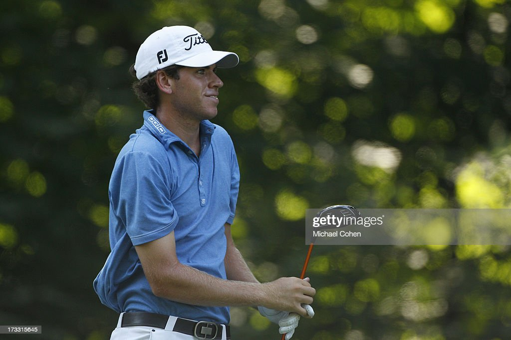 Ben Kohles reacts to his drive during the first round of the John Deere Classic held at TPC Deere Run on July 11, 2013 in Silvis, Illinois.