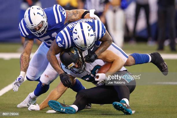 Ben Koyack of the Jacksonville Jaguars is tackled by Antonio Morrison and John Simon of the Indianapolis Colts during the first half at Lucas Oil...