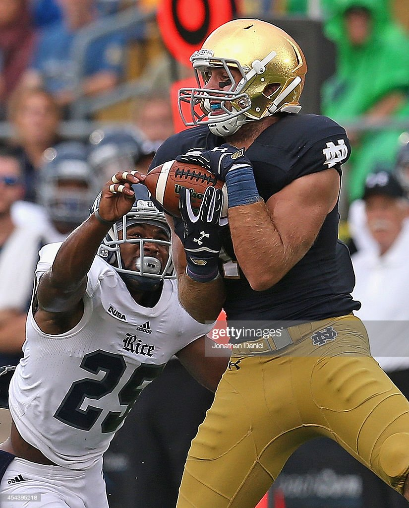 Ben Koyack of the Notre Dame Fighting Irish catches a first down ball over Jaylon Finner of the Rice Owls at Notre Dame Stadium on August 30 2014 in...