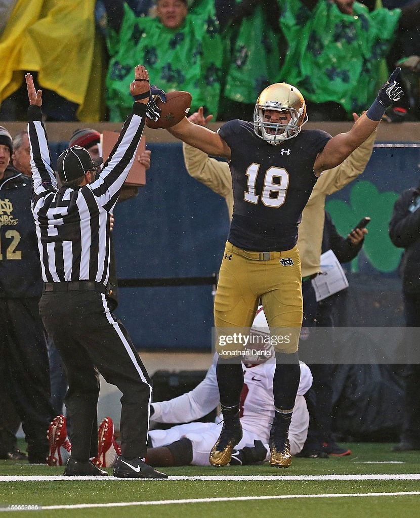 Ben Koyack of the Notre Dame Fighting Irish celebrates catching the gamewinning touchdown pass over Jordan Richards of the Standford Cardinal at...