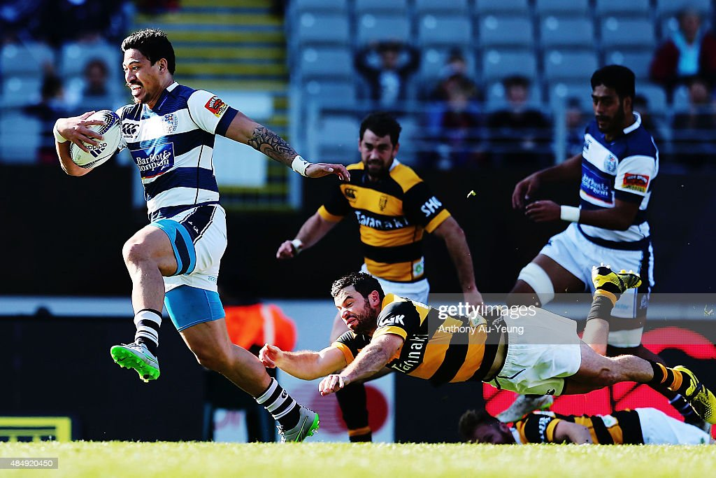 Ben Lam of Auckland beats the tackle from James Marshall of Taranaki to runs in a try during the round two ITM Cup match between Auckland and...
