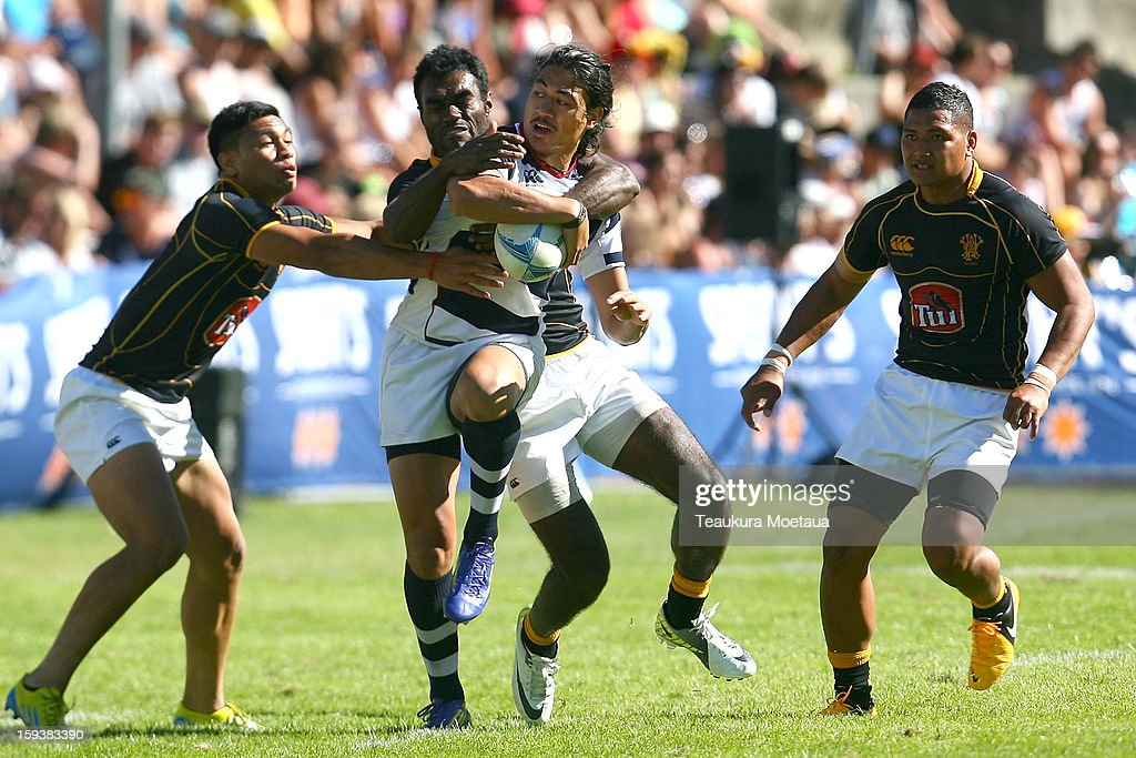 Ben Lam of Auckland is tackled against Wellington during the National Rugby Sevens plate final at the Queenstown Recreation Ground on January 13, 2013 in Queenstown, New Zealand.