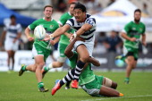 Ben Lam of Auckland passes the ball while being tackled during the match between Auckland and Manawatu during the NZRU National Sevens tournament on...