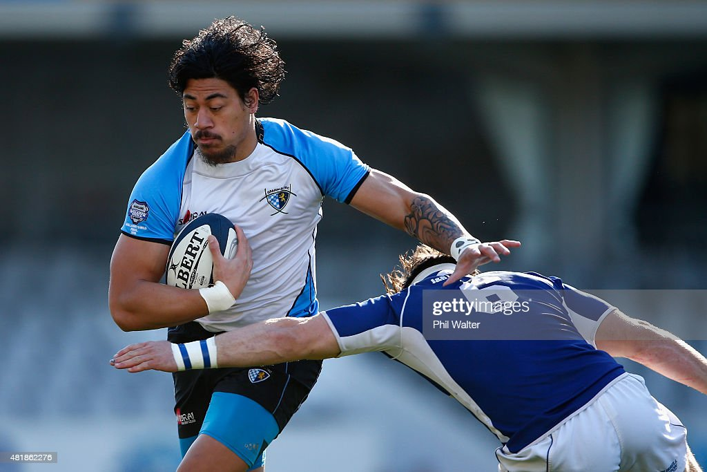 Ben Lam of Grammar Tec is tackled by Kurt Eklund of University during the Auckland Club Rugby match between University and Grammar TEC at Eden Park...