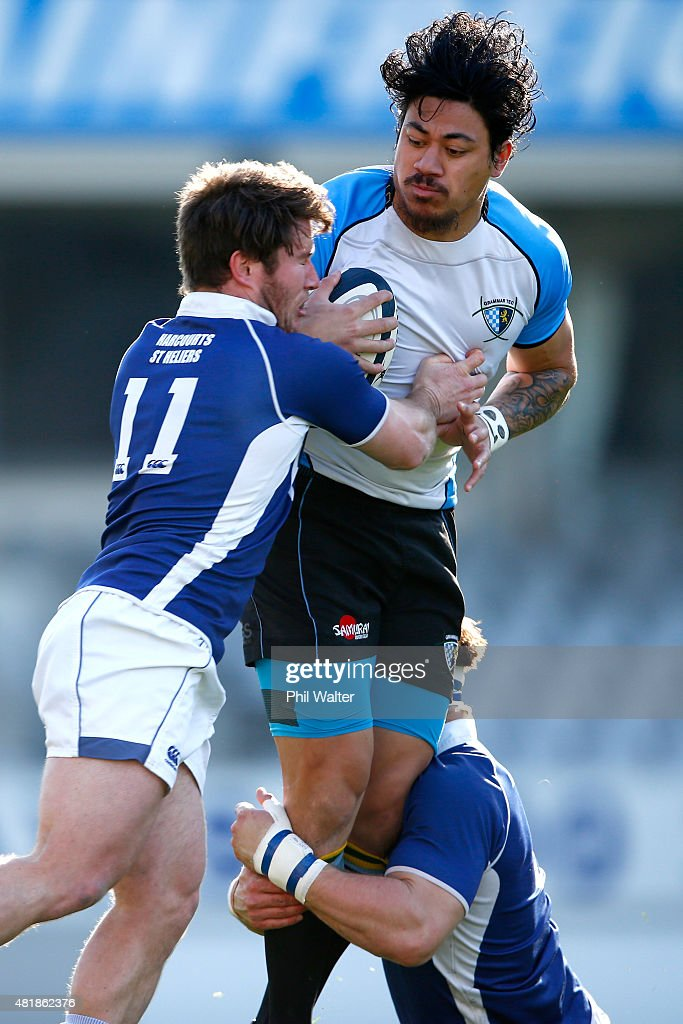 Ben Lam of Grammar Tec is tackled by Lachlan Cooper of University during the Auckland Club Rugby match between University and Grammar TEC at Eden...