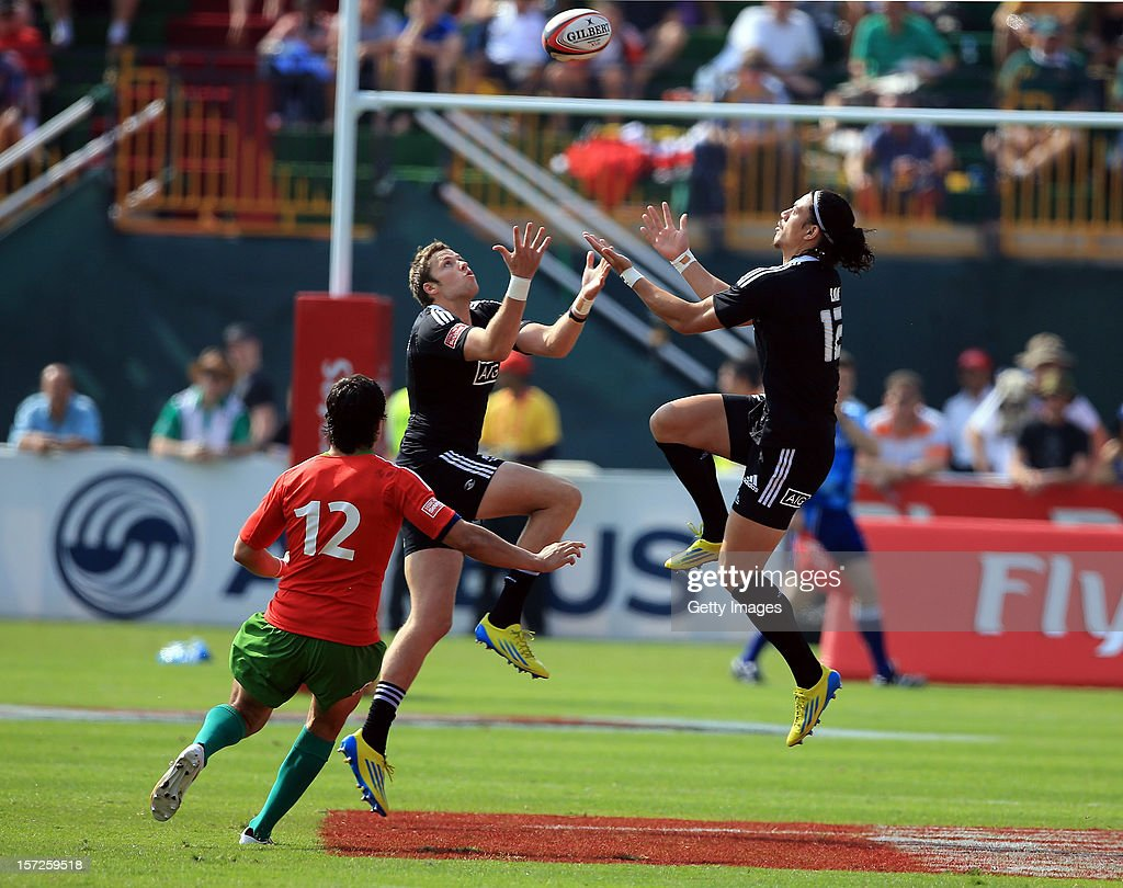 Ben Lam of New Zealand and Scott Curry of New Zealand both climb for the ball as Miguel Lucas of Portugal looks on during the Dubai Cup Quarter Final match during the Emirates IRB Dubai Sevens, Round 2 of the HSBC Sevens World Series on December 1, 2012 in Dubai, United Arab Emirates.