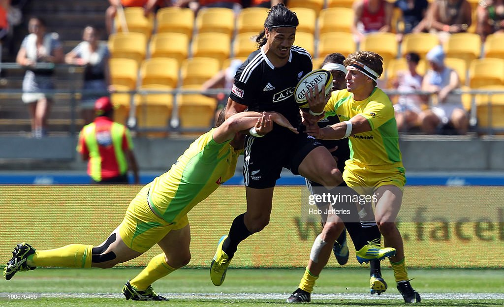 Ben Lam of New Zealand attempts to bust the Australia defence during the Hertz Sevens, Round four of the HSBC Sevens World Series Westpac Stadium on February 2, 2013 in Wellington, New Zealand.