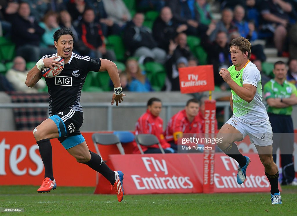 Ben Lam of New Zealand breaks free of the South African Defence to score a try during the IRB Glasgow Sevens Day One at Scotstoun Stadium on May 3...