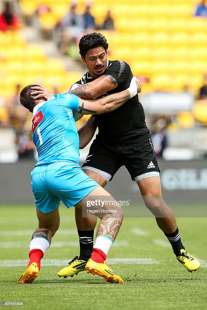 Ben Lam of New Zealand fends Vladimir Ostroushko of Russia during the 2016 Wellington Sevens pool match between New Zealand and Russia at Westpac...