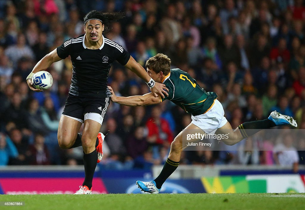 Ben Lam of New Zealand holds off Kwagga Smith of South Africa during the final match between South Africa and New Zealand at Ibrox Stadium during day...