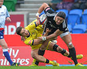 Ben Lam of New Zealand is tackled by Greg Jeloudev of Australia during the IRB Glasgow Sevens Day Two at Scotstoun Stadium on May 4 2014 in Glasgow...
