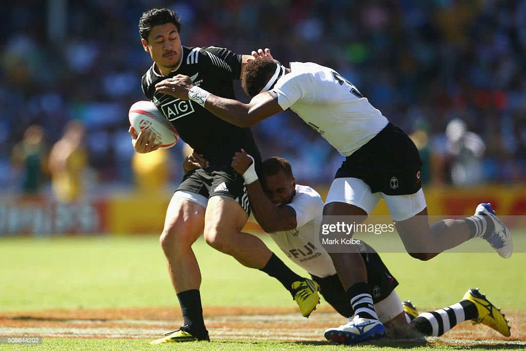 <a gi-track='captionPersonalityLinkClicked' href=/galleries/search?phrase=Ben+Lam&family=editorial&specificpeople=8776802 ng-click='$event.stopPropagation()'>Ben Lam</a> of New Zealand is tackled during the 2016 Sydney Sevens cup semi final match between New Zealand and Fiji at Allianz Stadium on February 7, 2016 in Sydney, Australia.