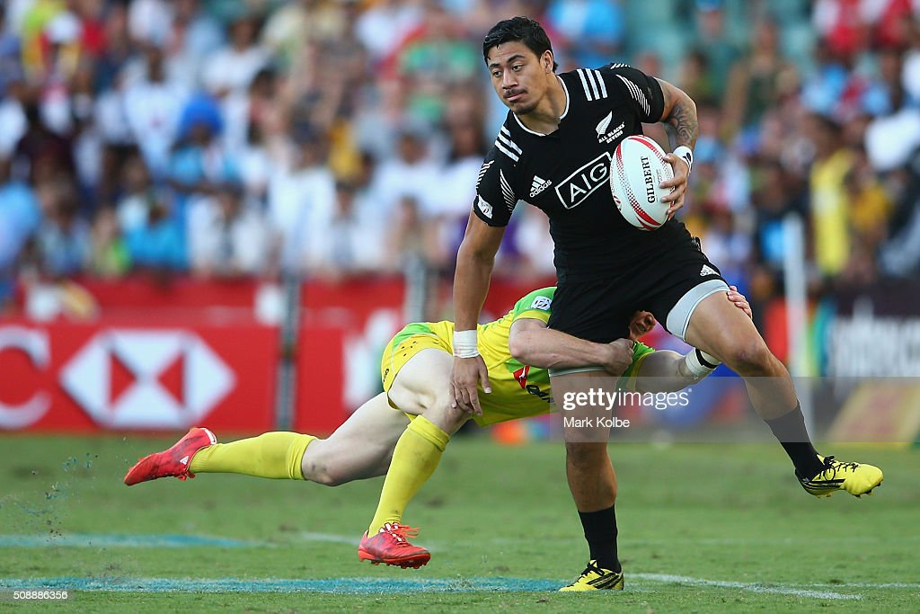 Ben Lam of New Zealand is tackled during the 2016 Sydney Sevens cup final match between Australia and New Zealand at Allianz Stadium on February 7...