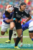 Ben Lam of New Zealand is tackled during the Cup Quarter Final match between New Zealand and Samoa during day three of the 2013 Hong Kong Sevens at...
