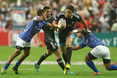 Ben Lam of New Zealand makes a break during the Pool D match between New Zealand and Samoa during day two of the 2014 Hong Kong Sevens at Hong Kong...
