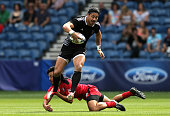 Ben Lam of New Zealand makes a break in the Rugby Sevens match between New Zealand and Canada at Ibrox Stadium during day three of the Glasgow 2014...