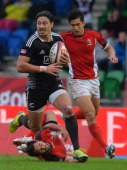 Ben Lam of New Zealand outruns the Canada defence during the IRB Glasgow Sevens Day Two at Scotstoun Stadium on May 4 2014 in Glasgow Scotland