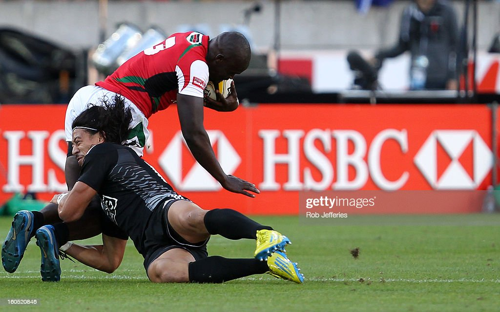 Ben Lam of New Zealand tackles Horace Otieno of Kenya during the Hertz Sevens, Round four of the HSBC Sevens World Series Westpac Stadium on February 2, 2013 in Wellington, New Zealand.