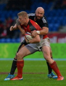 Ben Lam of New Zealand tackles John Moonlight of Canada during the IRB Glasgow Sevens Day Two at Scotstoun Stadium on May 4 2014 in Glasgow Scotland