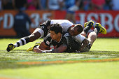 Ben Lam of New Zealand under pressure from Osea Kolinisau of Fiji scores a try during the 2016 Sydney Sevens cup semi final match between New Zealand...