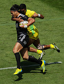 Ben Lam of the All Blacks Sevens is tackled by Pama Fou of Australia in the quarterfinal cup match between New Zealand and Australia during the 2013...