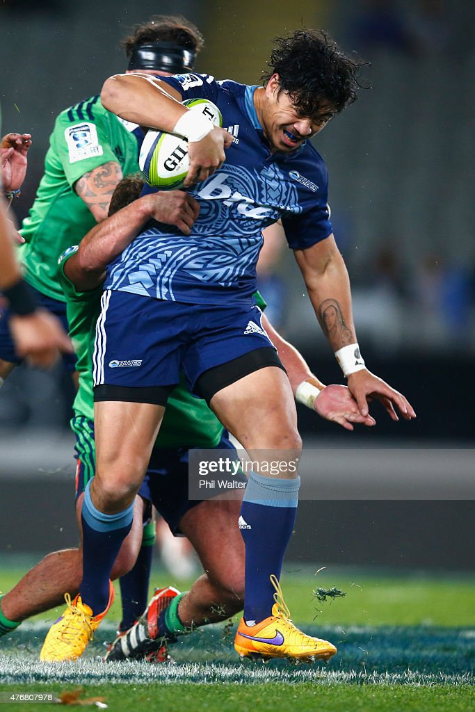 Ben Lam of the Blues is tackled during the round 18 Super Rugby match between the Blues and the Highlanders at Eden Park on June 12 2015 in Auckland...