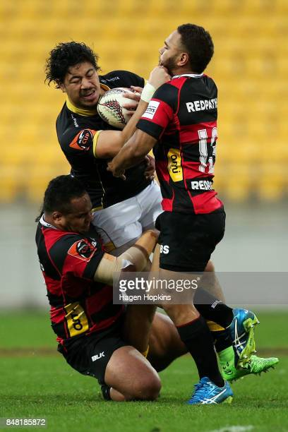 Ben Lam of Wellington is tackled by Inga Finau and Siate Tokolahi of Canterbury during the round five Mitre 10 Cup match between Wellington and...
