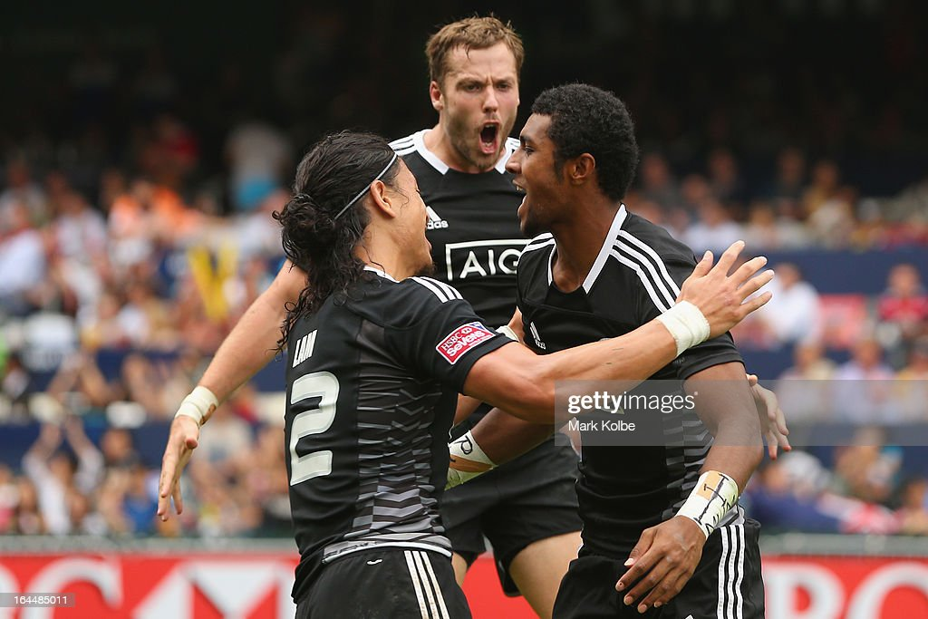 Ben LamTim Mikkelson and Luke Masirewa of New Zealand celebrate a try during the cup quarter final match between New Zealand and Samoa day three of...