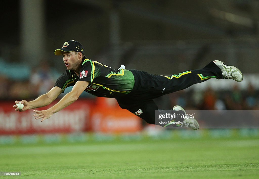 Ben Laughlin of Australia dives to take a catch and dismiss Tillakaratne Dilshan of Sri Lanka during game one of the Twenty20 international match between Australia and Sri Lanka at ANZ Stadium on January 26, 2013 in Sydney, Australia.