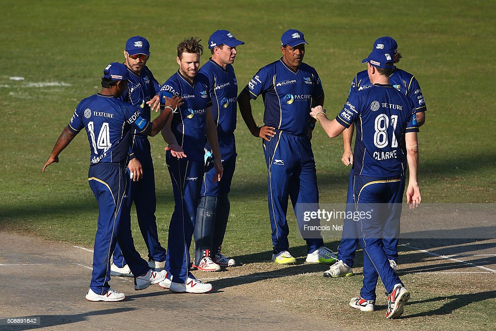Ben Laughlin of Capricorn celebrates the wicket of John Mooney of Virgo with his team-mates during the Oxigen Masters Champions League match between Virgo Super Kings and Capricorn Commanders on February 7, 2016 in Sharjah, United Arab Emirates.