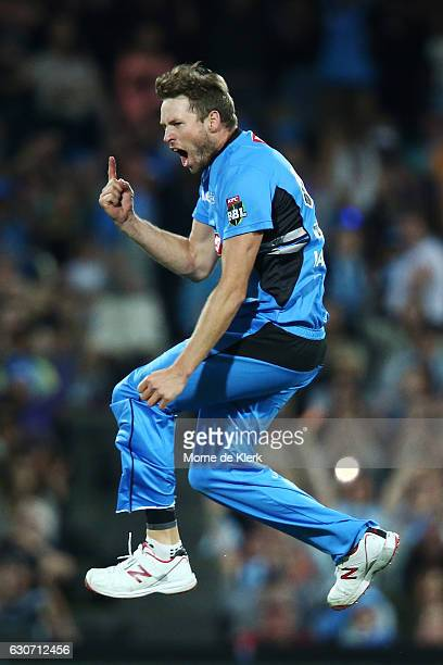 Ben Laughlin of the Adelaide Strikers celebrates after getting the wicket of Johan Botha of the Sydney Sixers during the Big Bash League match...