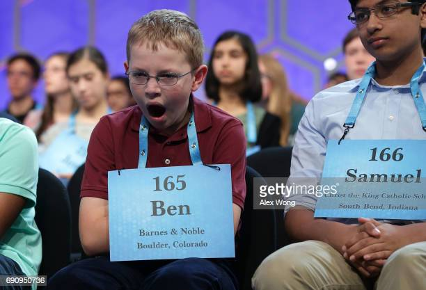 Ben Lenger of Niwot Colorado yawns as he waits on stage during round two of 2017 Scripps National Spelling Bee at Gaylord National Resort Convention...