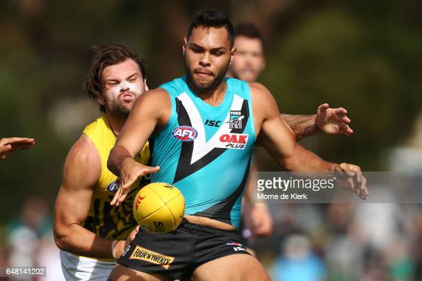 Ben Lennon of the Tigers tackles Jarman Impey of the Power during the 2017 JLT Community Series AFL match between the Port Adelaide Power and the...