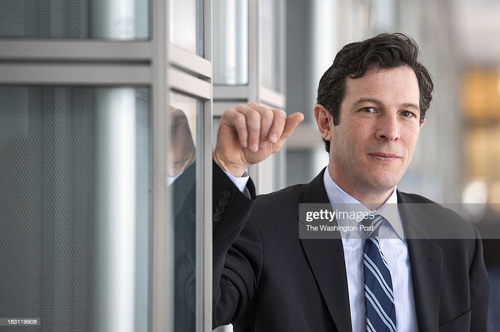 Ben Lieber poses in the Ronald Reagan building Thursday February 28, 2013 in Washington, DC. The former rocket engineer has launched a business, Potomac Law Group, that finds part time work for attorneys. They share office space at 1300 Pennsylvania Ave.