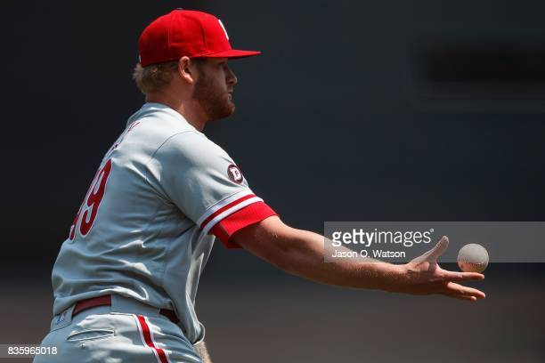 Ben Lively of the Philadelphia Phillies tosses to first base to force out Denard Span of the San Francisco Giants during the first inning at ATT Park...
