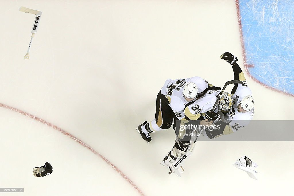 <a gi-track='captionPersonalityLinkClicked' href=/galleries/search?phrase=Ben+Lovejoy&family=editorial&specificpeople=4509565 ng-click='$event.stopPropagation()'>Ben Lovejoy</a> #12, <a gi-track='captionPersonalityLinkClicked' href=/galleries/search?phrase=Ian+Cole&family=editorial&specificpeople=4361308 ng-click='$event.stopPropagation()'>Ian Cole</a> #28 and <a gi-track='captionPersonalityLinkClicked' href=/galleries/search?phrase=Matt+Murray+-+Ice+Hockey+Player&family=editorial&specificpeople=15609595 ng-click='$event.stopPropagation()'>Matt Murray</a> #30 of the Pittsburgh Penguins celebrate after their 3-1 victory to win the Stanley Cup against the San Jose Sharks in Game Six of the 2016 NHL Stanley Cup Final at SAP Center on June 12, 2016 in San Jose, California.